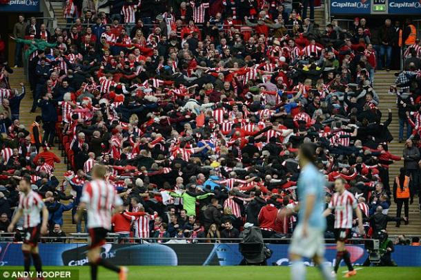 Above: Sunderland fans in celebration during their 3-1 defeat to Manchester City in the 2014 League Cup final