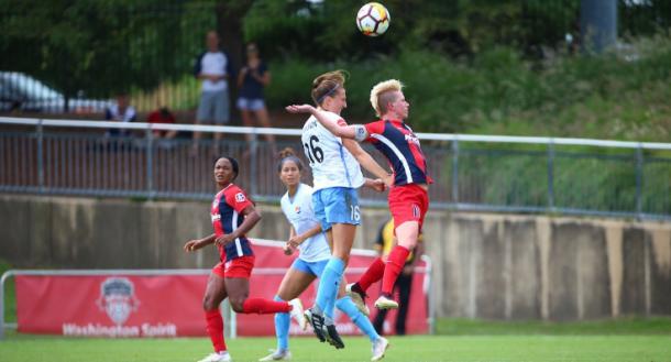 Sky Blue's Sarah Killion (16) challenged Washington's Johanna Lohman for a header. | Photo: isiphotos.com