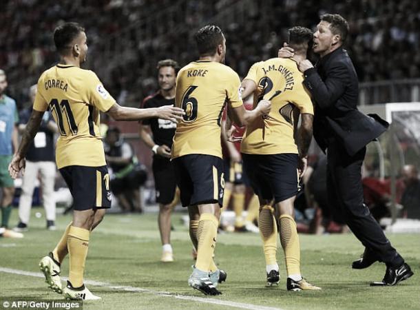 Los jugadores del Atleti celebrando un gol con el Cholo | Foto: AFP/Getty Images
