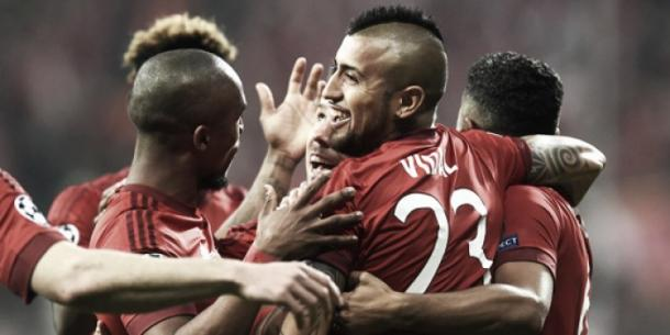 Vidal celebrates with his Bayern teammates after scoring in last week's first leg. (Photo: Getty)