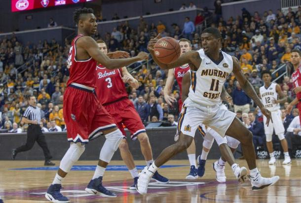 Amanze Ekegeze tries to knock the ball away from Murray State's