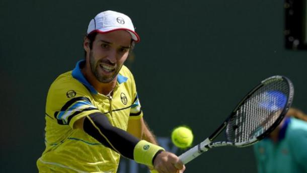 Mikhail Kukushkin, of Kazakhstan, returns a shot from Kei Nishikori during their match at the BNP Paribas Open tennis tournament, Sunday, March 13, 2016, in Indian Wells, Calif. (AP Photo/Mark J. Terrill)