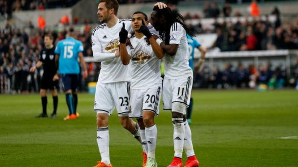 Montero, centre, celebrates scoring for Swansea City last season | Photo: ITV