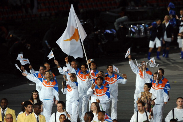 Baghdatis holds his country's flag aloft during the 2012 Olympics opening ceremony (Photo: Getty Images/Laurence Griffiths)