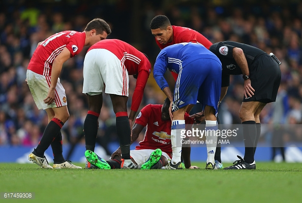 Bailly leaving the pitch after getting injured against Chelsea. Image Courtesy - Getty