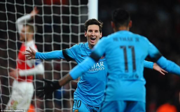 Lionel Messi celebrates a goal against Arsenal in midweek (photo: Graham Chadwick)