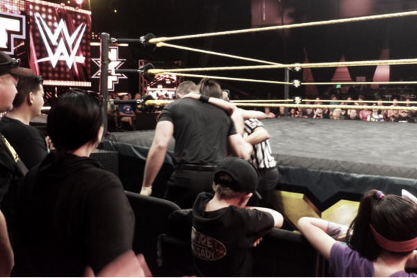 Bayley needed assistance getting to the back. Photo- Twitter