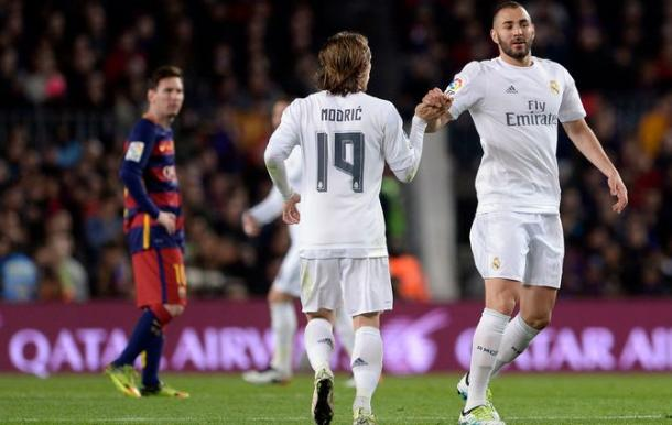 Benzema celebrates a goal on Saturday with Messi, who was kept out, looks on (photo: getty)