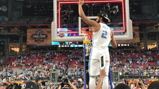 Berry cutting down a piece of the net. | Photo: UNC Basketball