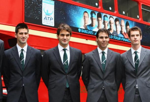 the Big Four stand outside one of the famed London double-decker buses/Getty