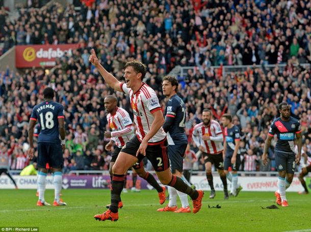 Billy Jones celebrates in the 3-0 win at the start of the season (photo: BPI)