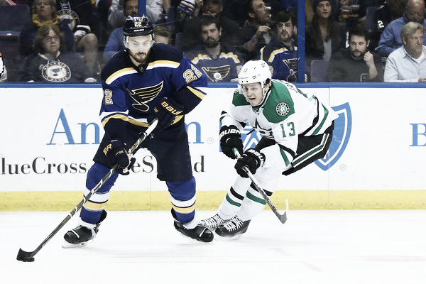 Kevin Shattenkirk #22 of the St. Louis Blues passes the puck against Mattias Janmark #13 of the Dallas Stars in Game Six of the Western Conference Second Round during the 2016 NHL Stanley Cup Playoffs at the Scottrade Center on May 9, 2016 in St. Louis, Missouri. (May 8, 2016 - Source: Dilip Vishwanat/Getty Images North America)