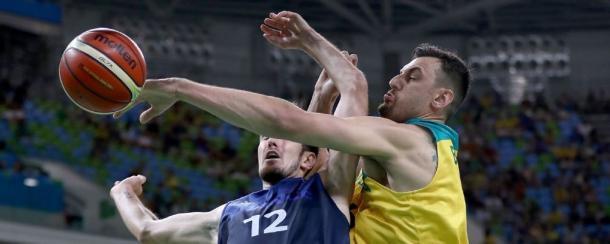 Andrew Bogut blocking France's Nando de Colo's (12) shot. Photo: Elsa/Getty Images