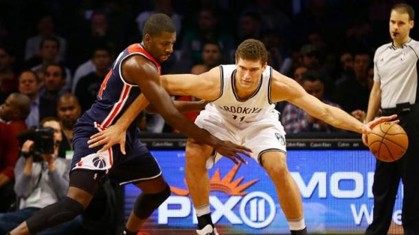 Forward Andrew Nicholson defending against Nets Center Brook Lopez. Photo by Andy Marlin/USA Today Sports Images.