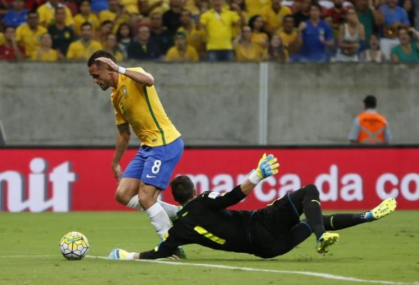 Renato Augusto scoring. Photo: AP Photo/Leo Correa