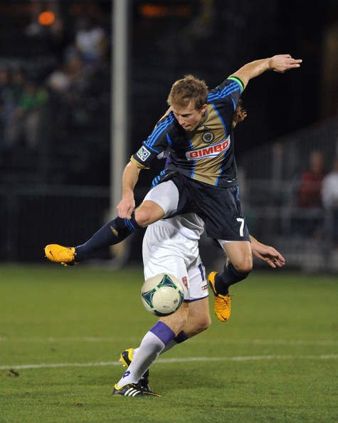 Brian Carroll challenges for the ball. Image Courtesy of Al Messerschmidt/Getty Images North America
