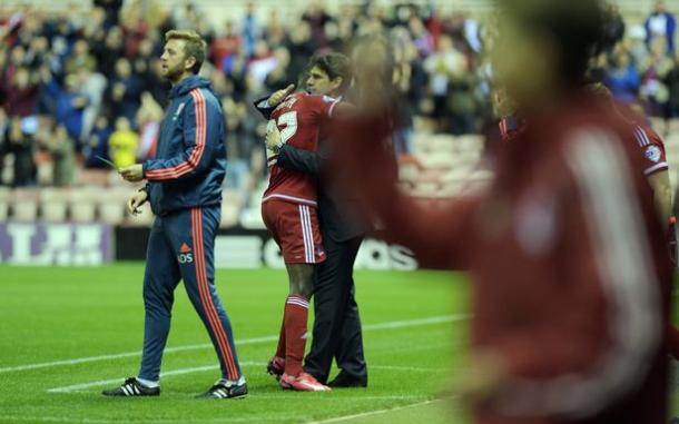 Adomah embraces Aitor Karanka after a falling-out between the pair | Photo: Gazette
