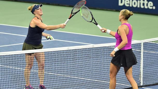 Brengle (left) and Rogers (right) tap racquets after the conclusion of their match. Photo: Andrew Ong