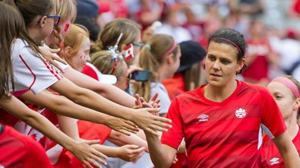 Legend Christine Sinclair bonding with fans after a solid game with Canada. Source: Rich Lam/Getty Images