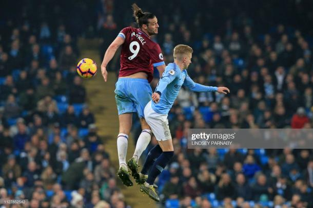 Caroll battles with Oleksandr Zinchenko of Manchester City at the Etihad Stadium back in February (Photo by Lindsey Parnaby/Getty Images)