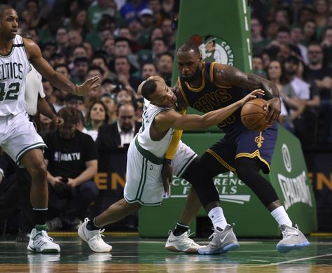 Boston Celtics guard Avery Bradley (0) attempts to steal the ball from Cleveland Cavaliers forward LeBron James (23). Photo:Bob DeChiara-USA TODAY Sports