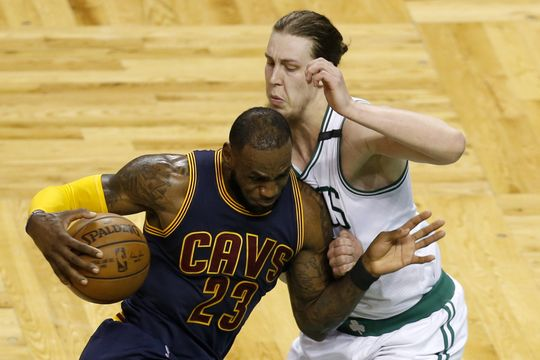 Cleveland Cavaliers forward LeBron James (23) drives towards Boston Celtics center Kelly Olynyk (41). Photo:Greg M. Cooper-USA TODAY Sports