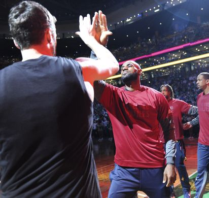 Cleveland Cavaliers forward LeBron James (23) gives a high five to forward Kevin Love (0) before the game. Photo:Bob DeChiara-USA TODAY Sports