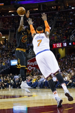 Cleveland Cavaliers Guard Kyrie Irving doing a shot attempt over New York Knicks Forward Carmelo Anthony. Photo Courtesy of Rick Osentoski-USA TODAY Sports.