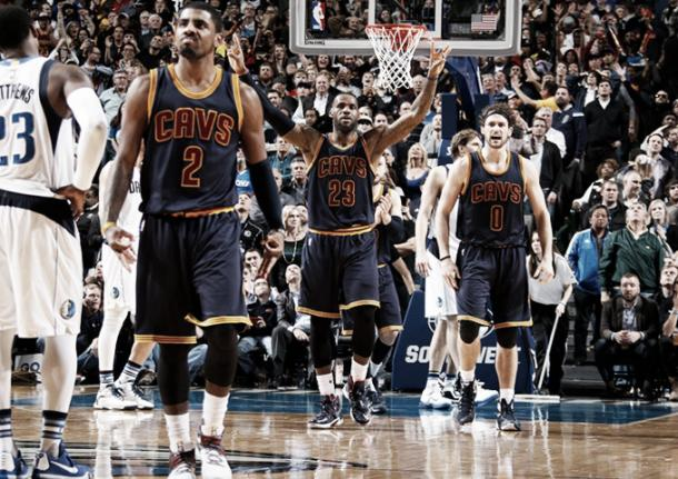 The Cavaliers celebrate after Kyrie Irving hits a big shot against the Dallas Mavericks. (Glenn James/NBAE/Getty Images)