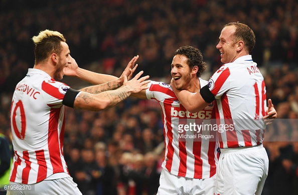 Marko Arnautovic, Ramadan Sobhi and Charlie Adam celebrate as Alfie Mawson scores an own goal during the Premier League match against Swansea City. | Photo: Michael Regan/Getty Images