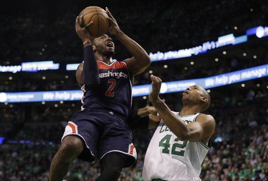 Washington Wizards guard John Wall (2) drives towards the rim as Boston Celtics center Al Horford (42) defends him. Photo:David Butler II-USA TODAY Sports