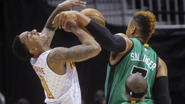 Jeff Teague battles Jared Sullinger for the ball.   Photo by A. Sherrod Blakely