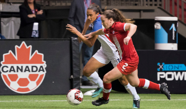 Canada's Allysha Chapman battles with United States forward Lynn Williams in a friendly match between the two sides. They will now play together for the North Carolina Courage in the NWSL. | Photo: Rich Lam - Getty Images