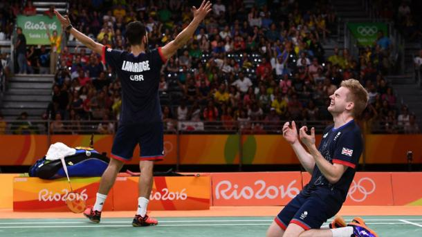 Chris Langridge and Marcus Ellis of Great Britain celebrate after winning badminton bronze. | Photo: PA