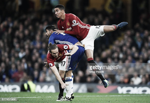 Chris Smalling played through the pain barrier last month against Chelsea Photo: Mike Hewitt/Gettyimages