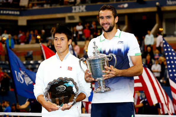 Cilic and Nishikori with their respective trophies following the conclusion of the US Open final in 2014 (Photo by Julian Finney / Getty Images)