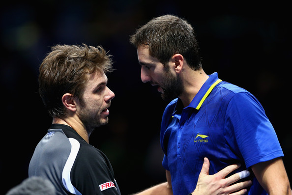 Cilic and Wawrinka shake hands at the net following their round robin meeting at the ATP World Tour Finals in 2014 (Photo by Clive Brunskill / Getty Images)