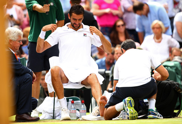Cilic received a medical timeout on the blister on his foot which was causing him discomfort (Photo by Clive Brunskill / Getty)