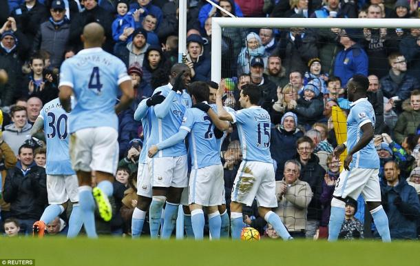 Manchester City players celebrate Yaya Toure's opening goal (photo: Reuters)