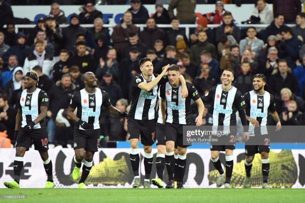 Newcastle players celebrate Ciaran Clark's winning goal against Bournemouth