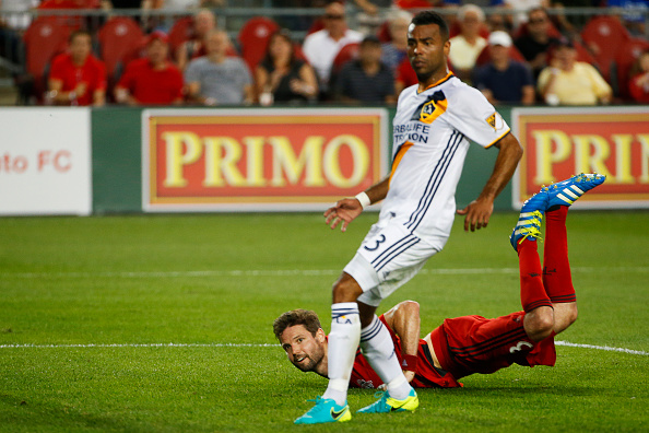 Ashley Cole watches as Drew Moor scores winning goal. | Photo: odd Korol/Toronto Star via Getty Images