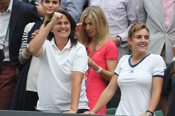 Martinez (left) was playing every point by point with Muguruza at Wimbledon in the coaching box (Photo by Tim Clayton / Corbis)