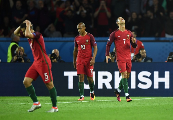 Cristiano (far right) has struggled to live up to expectations thus far, and Portugal have looked stifled. | Photo: Getty