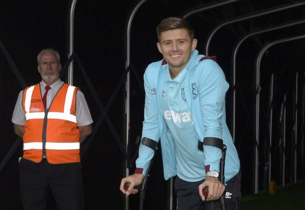 West Ham United full-back Aaron Cresswell on crutches after a knee ligament injury | Photo: whufc.com