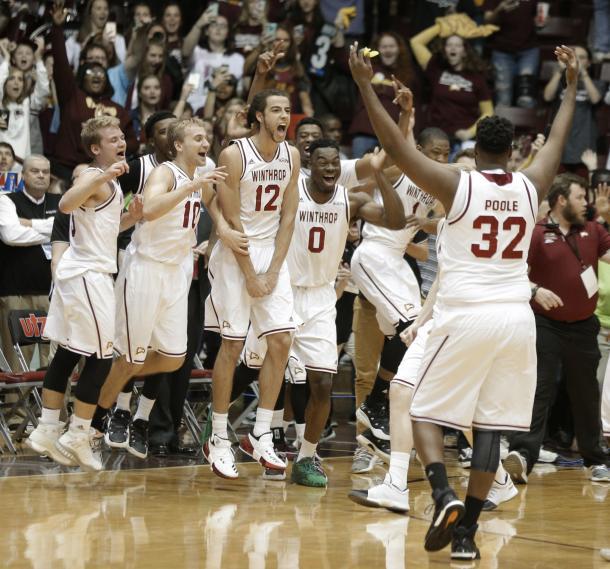 Winthrop players celebrate after clinching their first NCAA bid since 2010/Photo: Chuck Burton/Associated Press