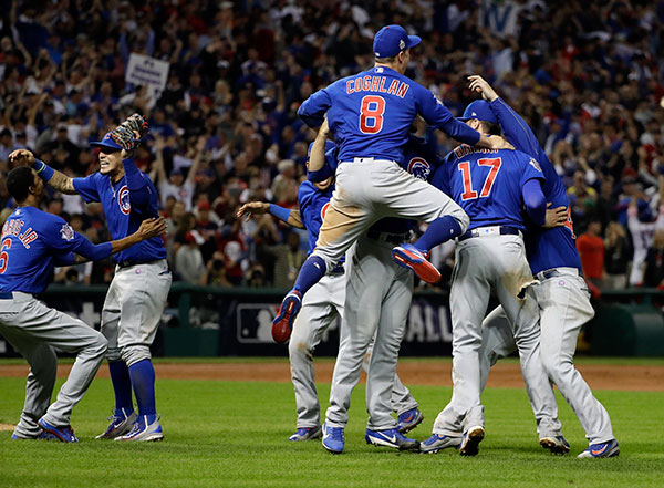 Cubs celebrate World Series in Cleveland. | Photo: AP Photo/David J. Phillip