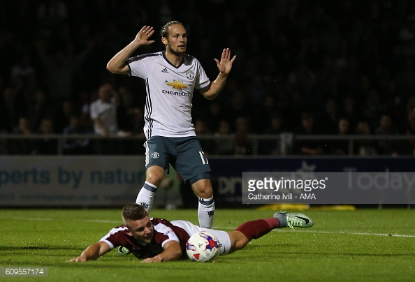Daley Blind Manchester United puts his hands up after he tackles Northampton Town's Sam Hoskins which leads to a penalty. | Photo: Catherine Ivill - AMA/Getty Images