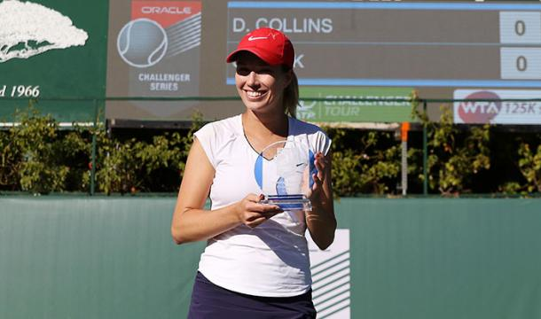 Danielle Collins posing alongside the biggest title of her career in Newport Beach | Photo: Oracle Challenger Series