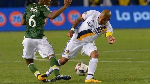 LA Galaxy's Nigel de Jong (Right) tackling Portland Timbers' Darlington Nagbe with his studs on Sunday at the StubHub Center. Photo provided by USA TODAY Sports.