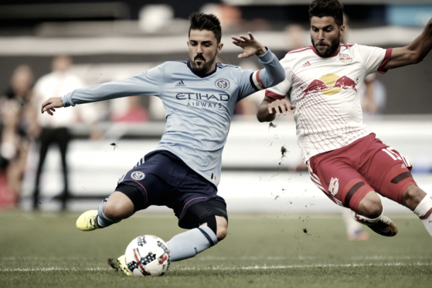 Sal Zizzo helps his keeper handle David Villa. | Photo: Noah K. Murray